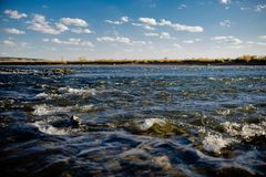 Flow of water close up. Quiet river water in the evening light background,flow of water close up stock photos
