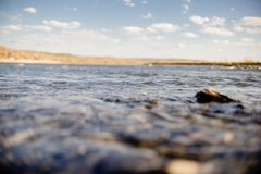 Flow of water close up. Quiet river water in the evening light background,flow of water close up stock photo