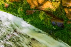 Flow and moss on rocks Stock Photography