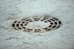 The flow of water after rain. Flows down through to storm water drain stock image