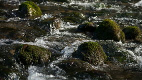 Flow of water through the rocks stock footage