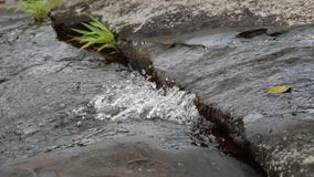 Flow water on stone stock footage
