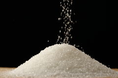 Flow of white sugar Stock Image