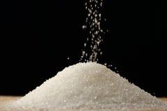 Flow of white sugar Stock Image