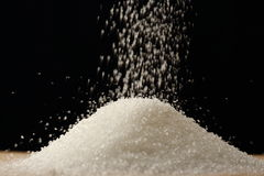 Flow of white sugar Royalty Free Stock Photography