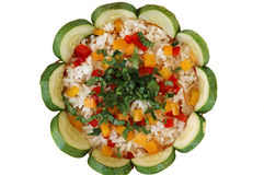 Flower. Rice pilaf with yellow pepper, red pepper, zuccini and parsley Royalty Free Stock Photos