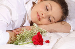 Flower. Women looking rose in bed Royalty Free Stock Photos