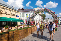Flower arch on reconstructed Klimentovsky lane in Moscow Stock Photo
