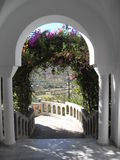 Flower arch. White arch decorated with flowers Stock Image