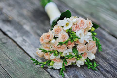 Flower Arrangement. Bridal bouquet of roses on a wood table Royalty Free Stock Photography
