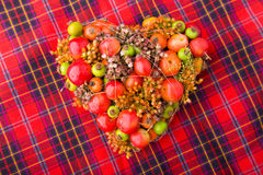 Flower arrangement. Heart-Shaped Flower Arrangement on a table royalty free stock image