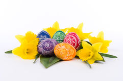 Flower arrangement with artistically painted Easter eggs Stock Photos