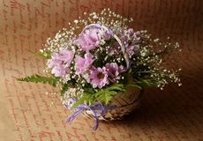 Flower arrangement in a basket royalty free stock image
