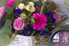 Flower arrangement in a basket decorate the wedding table in pur Royalty Free Stock Photography