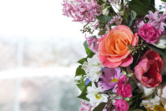 Flower arrangement. Beautiful colored flower arrangement with light background Stock Photo