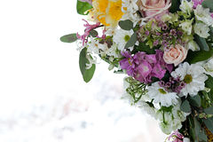 Flower arrangement. Beautiful colored flower arrangement with light background Royalty Free Stock Image