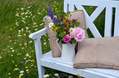 Flower arrangement on bench Stock Photography