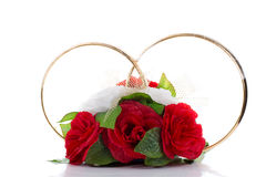 A flower arrangement with big golden rings Stock Photography