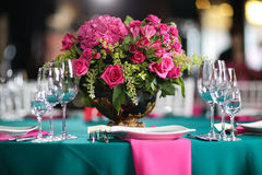 Flower arrangement in bowl with pink roses and hydrangea. table setting Stock Images