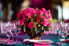 Flower arrangement in bowl with pink roses and hydrangea. table setting Stock Photos