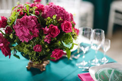 Flower arrangement in bowl with pink roses and hydrangea. table setting Stock Photo