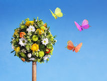 Flower arrangement with butterflies Stock Photo
