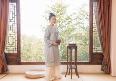 Flower arrangement-China tea ceremony. China woman show China tea ceremony in classical Chinese teahouse Royalty Free Stock Photos
