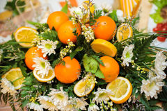 Flower arrangement of chrysanthemums and oranges. Autumn bouquet Royalty Free Stock Photo