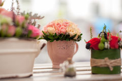 Flower arrangement close-up. Flower arrangement of multi-colored roses in the cup. Wedding ceremony. Floristic design close-up. Shallow DOF, selective focus Stock Photography