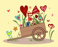 Flower arrangement of colorful hearts in a handcar. Flower arrangement from blooming hearts in the handcart.  Illustration symbolizing joy, love and happiness Royalty Free Stock Photos