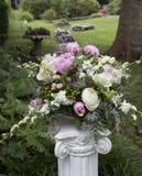 Flower arrangement on column Stock Image