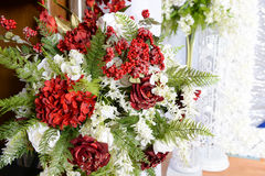 Flower Arrangement. Decor arangement with red and white flowers royalty free stock photos