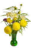Flower arrangement with ferns and yellow flowers Stock Images