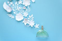 Flower arrangement. Flowers, fragrance, perfume. On blue background. Cut from paper stock images