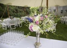 Flower arrangement and glasses Stock Photo