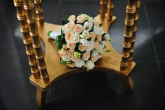 Flower Arrangement  and golden table Royalty Free Stock Images