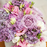 Flower arrangement with lilac and eustoma flowers Stock Image
