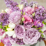 Flower arrangement with lilac and eustoma flowers Stock Images