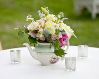 Flower arrangement in old tea pot Royalty Free Stock Photography