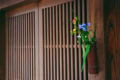 Flower arrangement outside Japanese doors Royalty Free Stock Photo