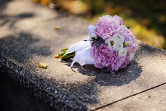 Flower Arrangement of peonies. On a stone Royalty Free Stock Photo