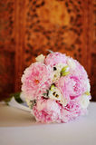 Flower Arrangement of peonies. On a table Royalty Free Stock Images