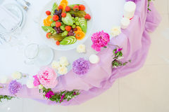 Flower arrangement pink violet lilac colors. Decoration flower arrangement pink violet lilac colors white tablecloth Stock Photography