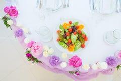 Flower arrangement pink violet lilac colors. Decoration flower arrangement pink violet lilac colors white tablecloth Stock Photos
