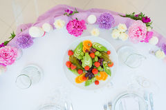 Flower arrangement pink violet lilac colors. Decoration flower arrangement pink violet lilac colors white tablecloth Royalty Free Stock Photo