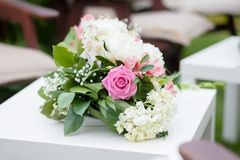 Flower arrangement with pink and white roses, wedding day, outdoors. Flower arrangement with pink and white roses and peonies, wedding day, outdoors Stock Image