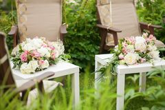 Flower arrangement with pink and white roses, wedding day, outdoors. Flower arrangement with pink and white roses and peonies, wedding day, outdoors Stock Photos