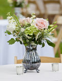 Flower arrangement in pitcher. Flower arrangement in old silver pitcher Royalty Free Stock Images
