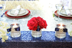 Flower Arrangement With Red Roses. And candles over sequence table stock photos