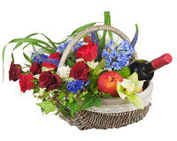 Flower arrangement of roses, orchids, fruits and bottle of wine. royalty free stock photos